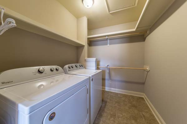 Walk-in Closet with Full Size Washer and Dryer